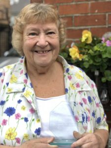 Picture of Diana Booth with her award for Age Friendly Sheffield Lifetime Achiever